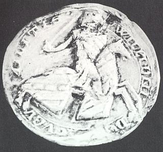 Rytířská pečeť z roku 1260, na níž Guillaume de Longueval už má štít i čabraku pokrytu rodovými symboly Buquoyů