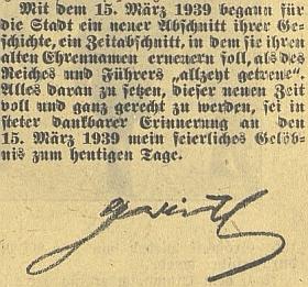 """Jeho podpis na závěr článku, ve kterém k 1.výročí vzniku protektorátu Čechy a Morava slavnostně slibuje nasadit všechny síly k tomu, být """"plně a zcela práv vděčné vzpomínce"""" na den 15. března 1939"""