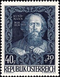 ... a poštovní známka z roku 1948 sportrétem sochařovým