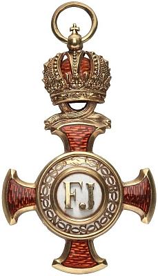 Zlatý záslužný kříž s korunou
