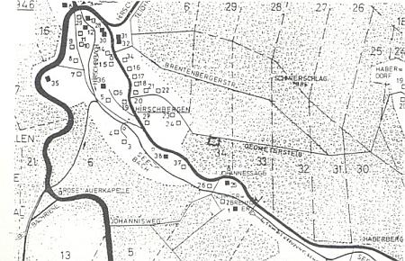 Mapka obce Jelení a pamětní kámen na cestě mezi Jelením aOvesnou z roku 1888
