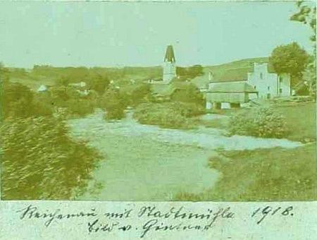 Jeho snímek Rychnova nad Malší v obecní kronice s městským mlýnem napravo při řece