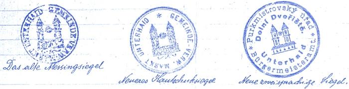 Tři podoby razítka městyse Dolní Dvořiště, jak je zachovala obecní kronika (razítko s dvojjazyčným nápisem vyhotovila firma J. Starý z Českých Budějovic)