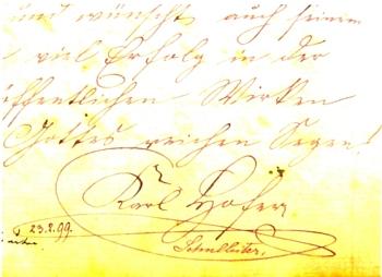 Jeho podpis v pamětní knize německé obecné školy v Dolních Chrášťanech, datovaný 23. února roku 1899