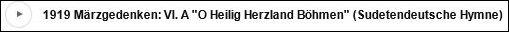 """Sudetoněmecká hymna neznámého autora, počínající slovy """"O Heilig Herzland Böhmen"""", tj. """"Svatá země srdce, Čechy"""" na části zvukového záznamu představení melodramatu """"Čeští legionáři"""" v podání Das schöne neue Musik Salonorchester a """"Sboru přátel sudetských Němců"""" pod vedením Alexandra Blechingera"""
