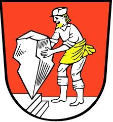 Znak městyse Wendelstein v bavorských Středních Frankách, kde Adolf Jaksch zemřel a kde je i na místním hřbitově pochován - znak zpodobuje v rudém poli na stříbrné ploše stojícího kameníka, celého vtéže stříbrné barvě jen se zlatým plnovousem a se zlatou zástěrou, stavícího tu velký stříbrný zašpičatělý valoun na jeho vrchol