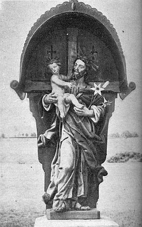 """Socha sv. Josefa s Ježíškem na křižovatce cest u samoty Schrankenhäusl (tj.""""domek u závory""""), o kterém je zmínka v jeho textu"""
