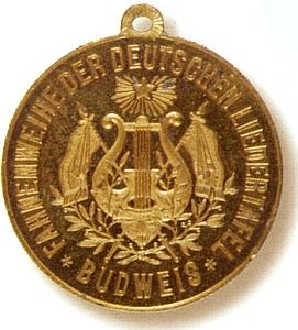 Líc medaile (1887) ke svěcení praporu pěveckého spolku Deutsche Liedertafel v Budějovicích, jehož byl spoluzakladatelem