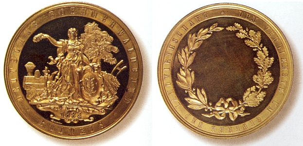 Líc a rub medaile sdružení Deutscher Böhmerwaldbund za zásluhy o řemesla a zemědělství z roku 1884, ražená vídeňskou firmou Josepha Christiana Christlbauera (1827-1897), rodáka z dnes zaniklých Cudrovic