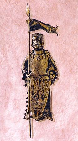 """Jen kus cesty od hřbitova v Sankt Oswald stojí před zdejším muzeem """"historie lesa"""" památník čtyř patronů kláštera, mezi nimiž nechybí ani český svatý Václav"""