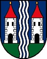 Znak jeho rodného městyse Vöcklamarkt, rekreačního a poutního místa v podhůří Alp
