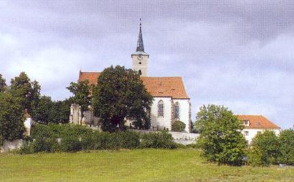 Kostel Nanebevzetí Panny Marie v Nezamyslicích s přilehlým hřbitovem a kaplí sv. Erazima, v níž je rodová hrobka Lamberků