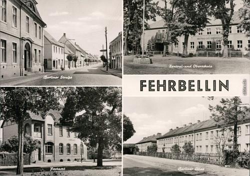 Pohlednice města Fehrbellin zobrazující místní Berliner Straße a Berliner Allee (podle mapy přechází jedna v druhou),     hlavní třídu města, která tedy zřejmě kdysi nesla jméno po Stalinovi