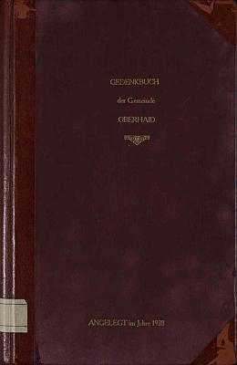 Desky a první strana kroniky obce Zbytiny s podpisem kronikářovým