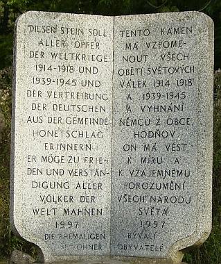 V roce 1997 vztyčili bývalí obyvatelé Hodňova, kteří jej musili opustit po druhé světové válce, při někdejší své domovské obci tento památník pro zamyšlení nám i budoucím