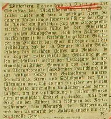 Novinový výstřižek ve vimperské městské kronice o zdejší oslavě 11. výročí Hitlerova nástupu k moci sRammelovou autorskou šifrou na konci - odkud jen všichni známe toho démona souhlasu?