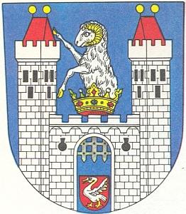 """Znak jeho rodného města Ronšperk (Poběžovice), který uchovává původní význam místního jména """"Ramsberg"""", tj.""""beraní vrch"""" - labuť ve štítu dole je erb  Švamberků (vonSchwanberg)"""