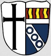 Znak bavorské obce Wartmannsroth, kde byl činný v letech 1946-1949 jako kooperátor zdejší farnosti a seznamoval se folklórním dědictvím strýčického jazykového ostrova