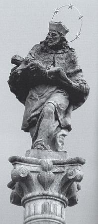 Socha jeho křestního patrona Nepomuka z roku 1722 vévodí sloupu na náměstí rodného Rožmberka nad Vltavou