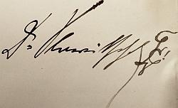 Jeho autogram z původního výtisku knihy Modrý Pánbůh sburšáckou značkou na konci (viz Wikipedia)