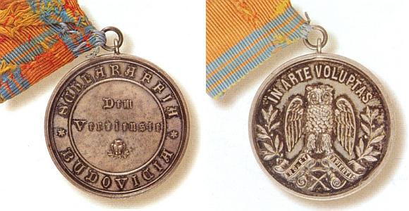 Záslužná medaile budějovického spolku Schlaraffia z přelomu 19. a 20. století