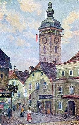 Pohlednice ze starých Budějovic podle originálu Gustava Braunera zachycuje barevný prapor na Černé věži, ohlašující podle otcových prognóz zdejší počasí