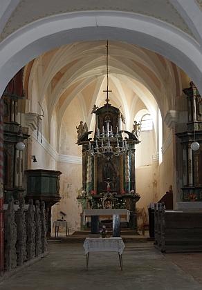 Drahotín, další jeho učitelské působistě, patřil k farnosti Hora svatého Václava (Berg), s opevněným kostelem, zasvěceným zemskému světci, kdeprý chtěl Womes koncem šedesátých let 20. století uspořádata setkání vyhnanců